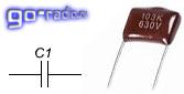 Внешний вид конденсатора и его обозначение на схеме